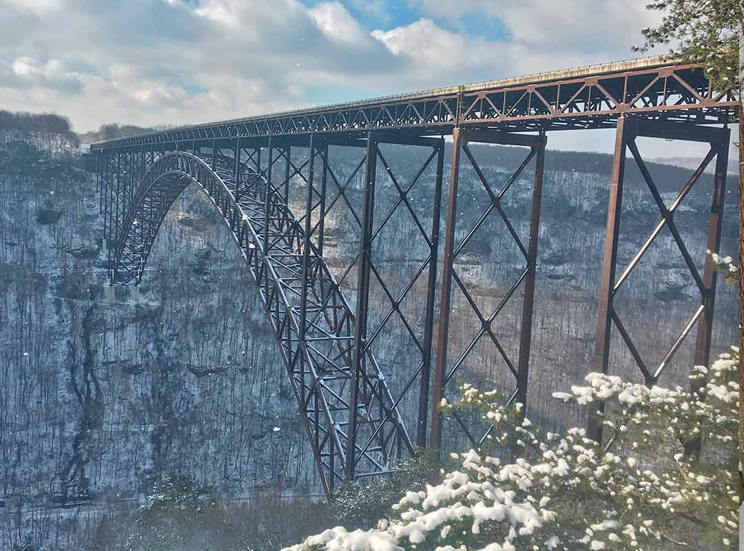 A view of the new river gorge winter featuring the snow covered bridge.