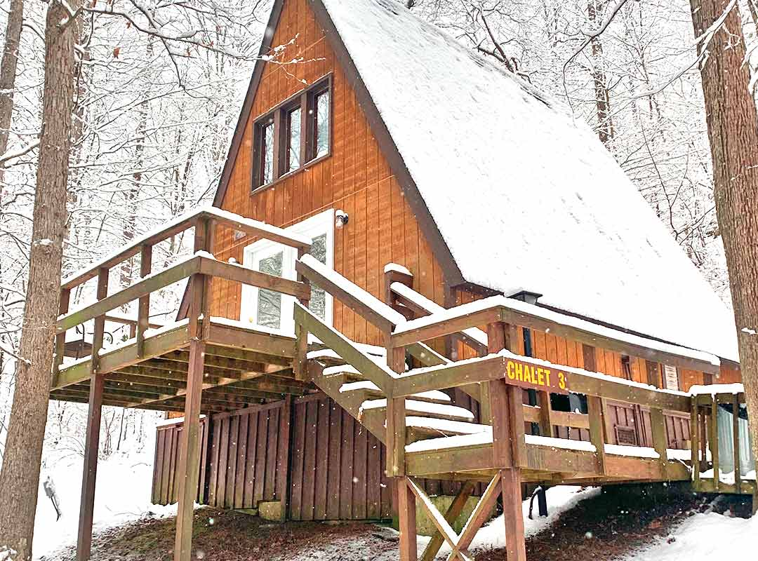 A view of one of ACE's classic chalets covered in snow during a New River Gorge winter in West Virginia.