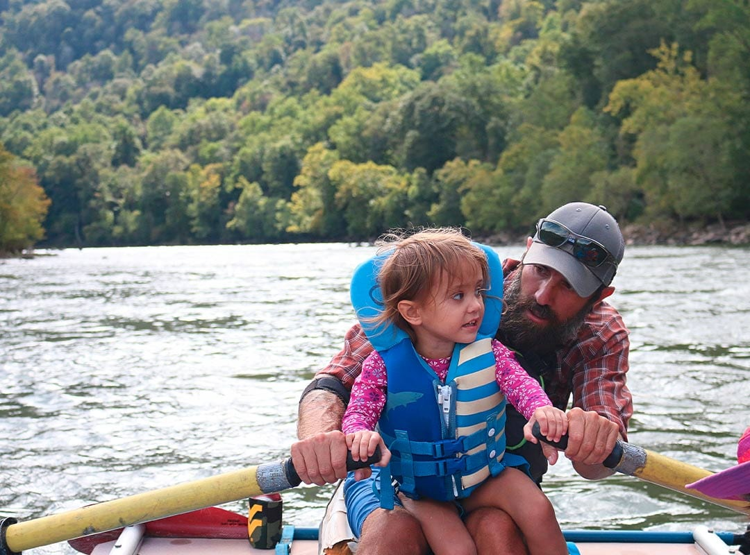 Father takes his daughter rafting on the Upper New