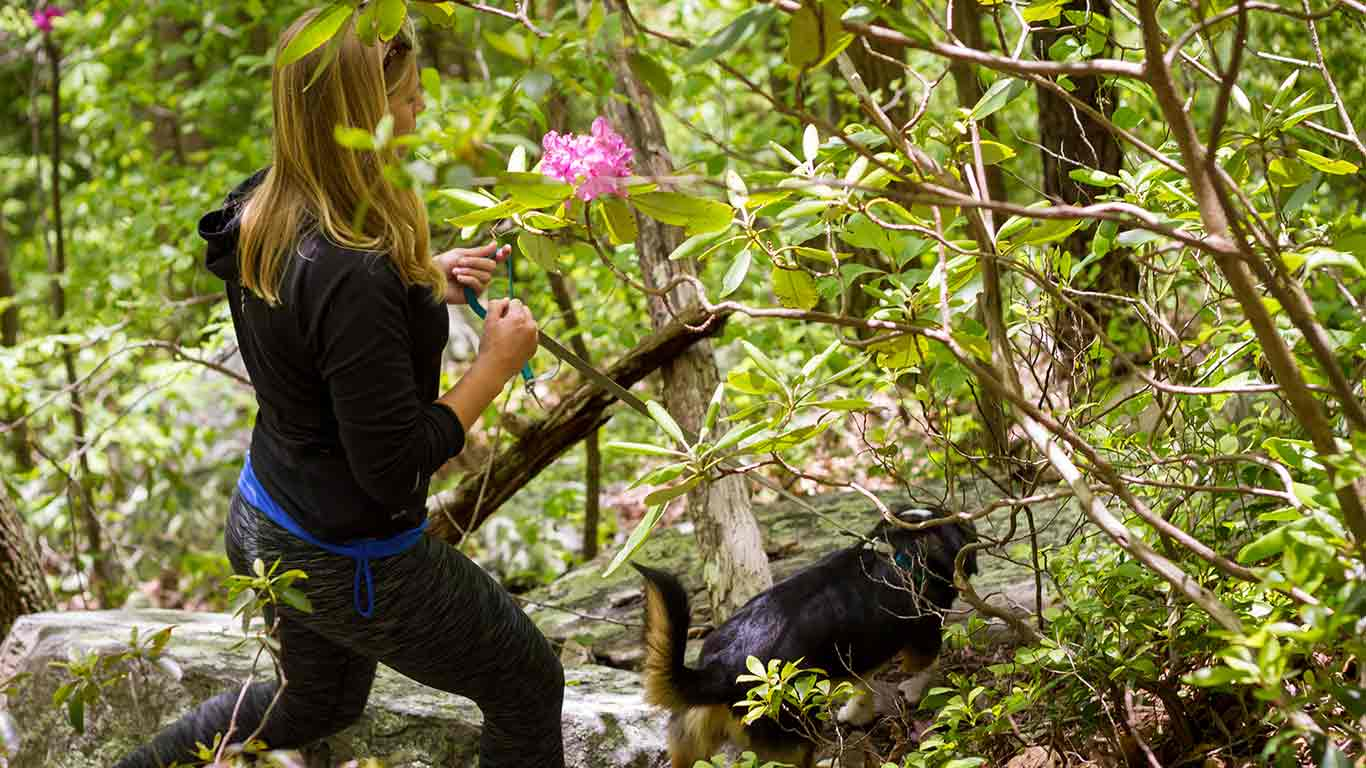 Woman enjoying a hike at ACE Adventure Resort for boots and boats overnight package