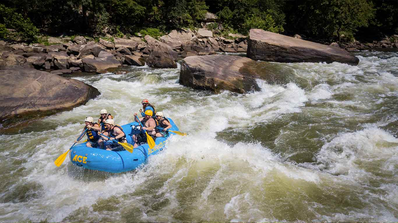 Guests rafting with ACE Adventure Resort