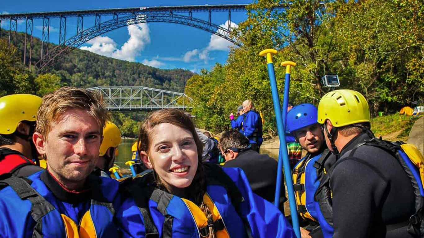 Rafting trip with New River Gorge Bridge in the background
