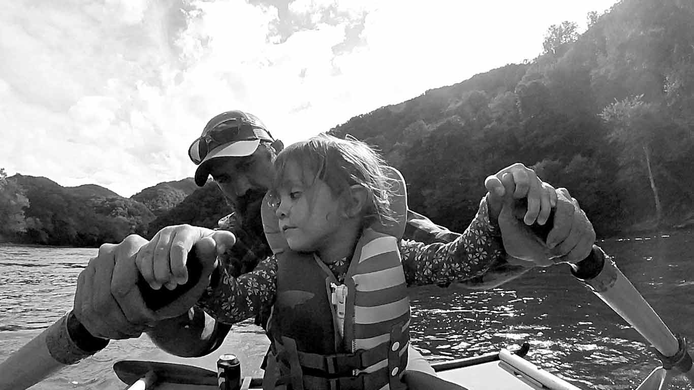 Father rafting with his daughter on the Upper New