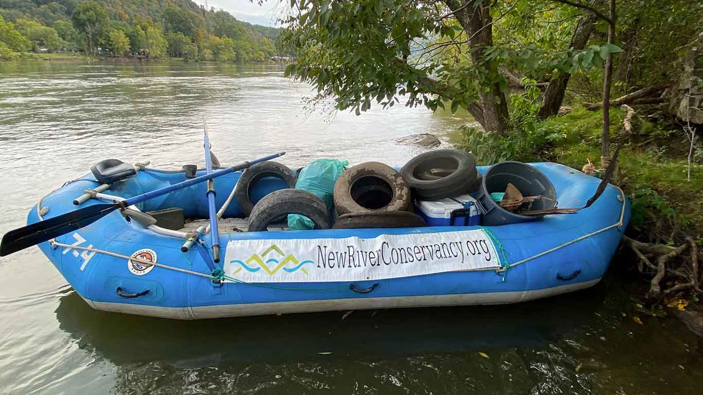 River clean up with tires in a raft