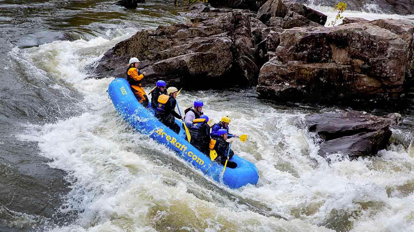 Group river rafting the Upper Gauley during fall gauley season