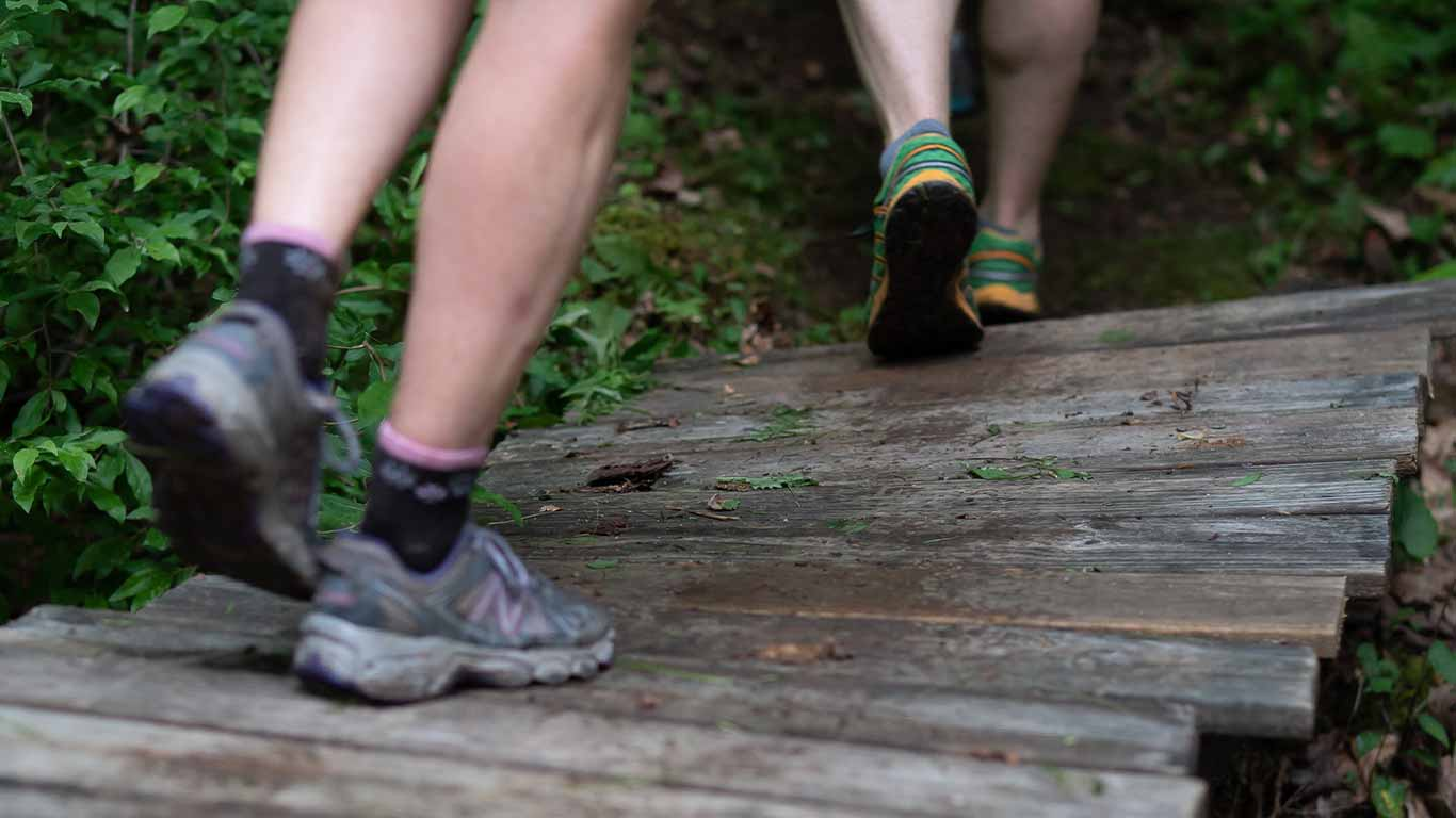 Trail runner's shoes on a bridge
