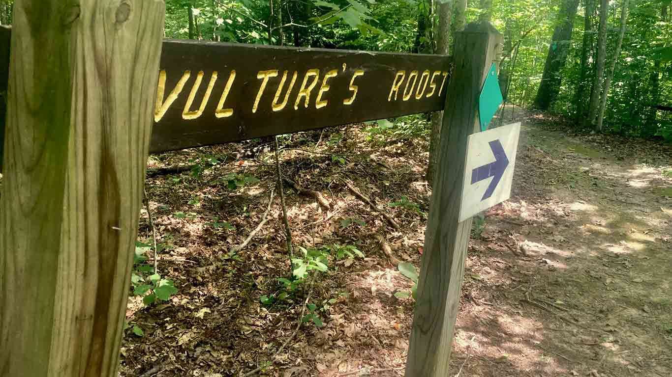 """Trail photo with a sign that reads """"Vulture's Roost"""""""