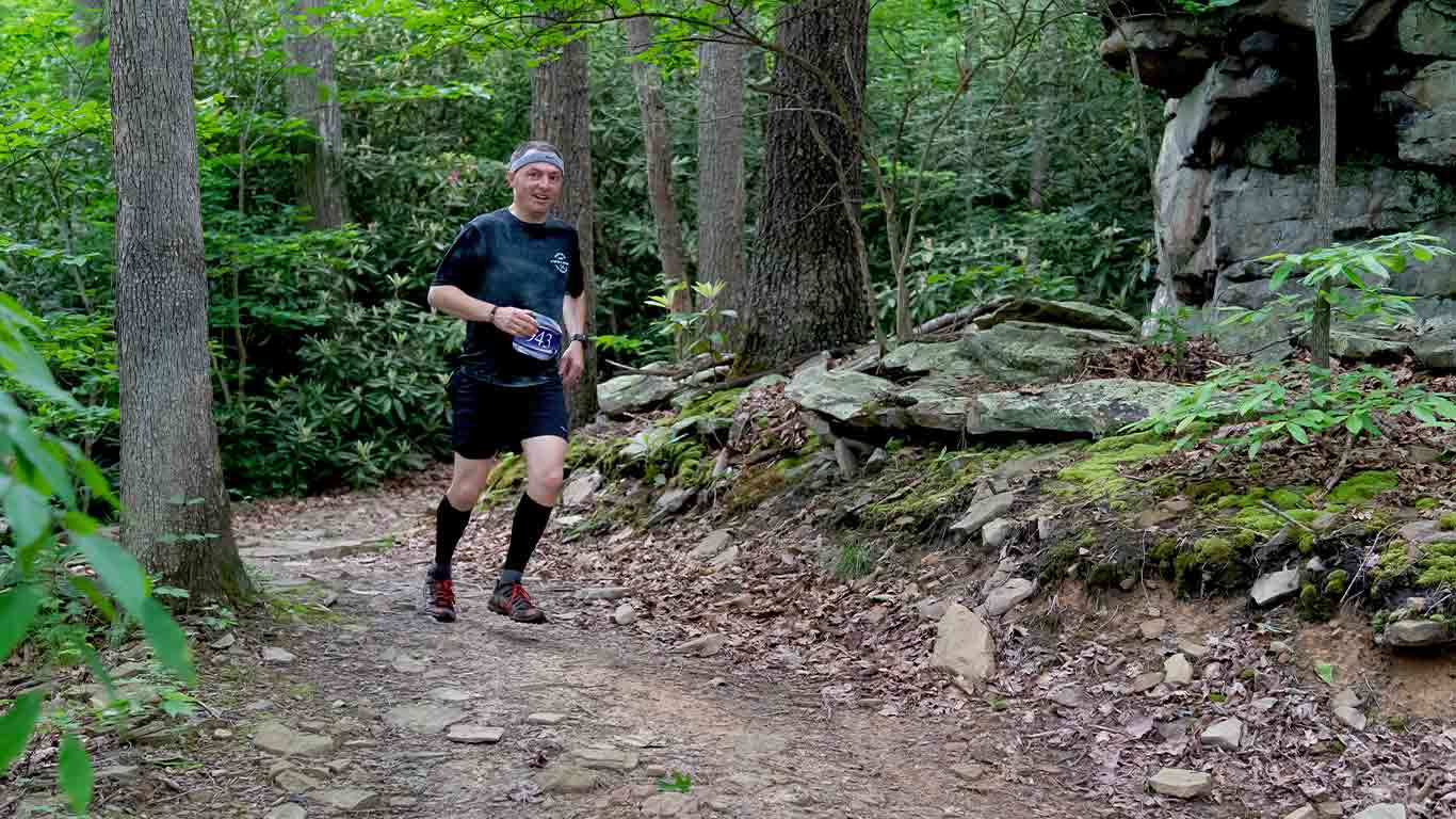 Trail runner on a trail at ACE Adventure Resort