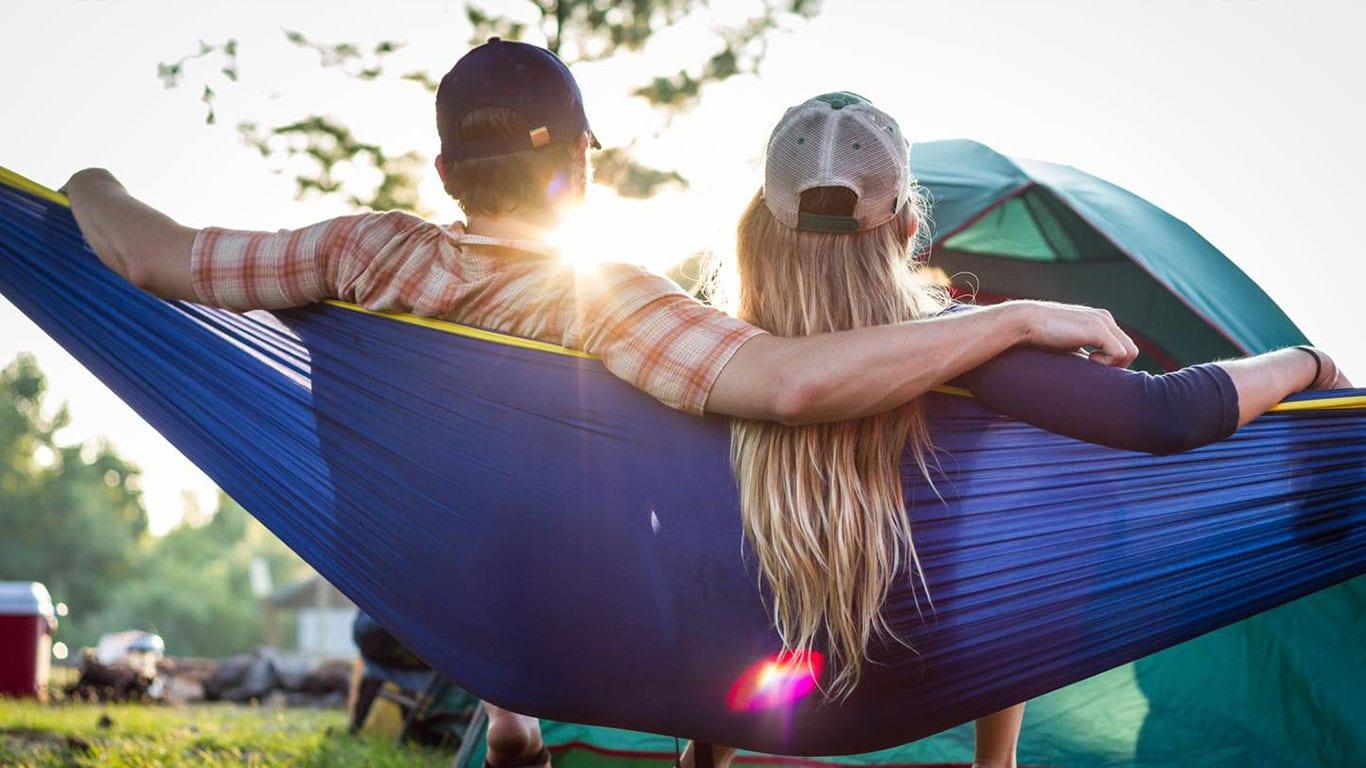 Couple relaxing in a hammock