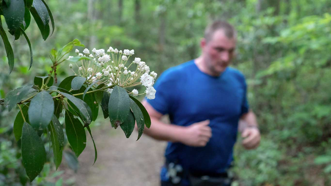 Runner with close up of flower